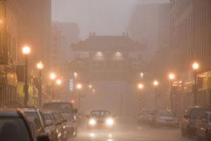 rain falls on an urban street